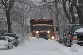 (Boston, MA - 1/27/15) A plow clears snow along a Dorchester street, Tuesday, January 27, 2015. Staff photo by Angela Rowlings.